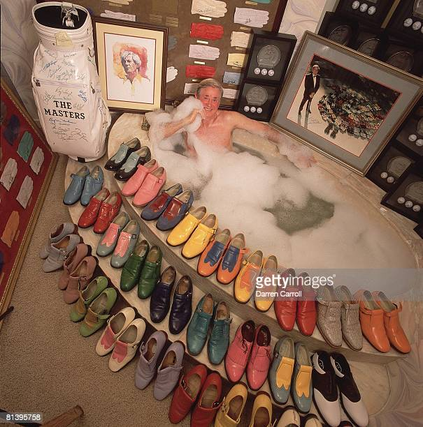 Golf Aerial casual portrait of Doug Sanders at home in bathtub with multiple pairs of shoes Houston TX 9/4/2001