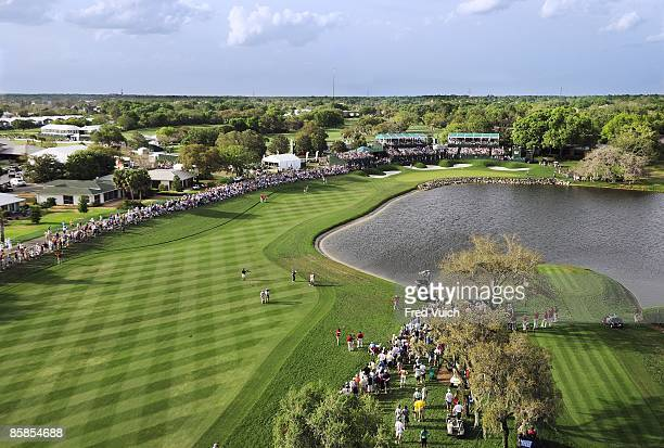 Arnold Palmer Invitational: Aerial view of Tiger Woods in action, shot after taking drop on No 18 during Saturday play at Bay Hill Club & Lodge....