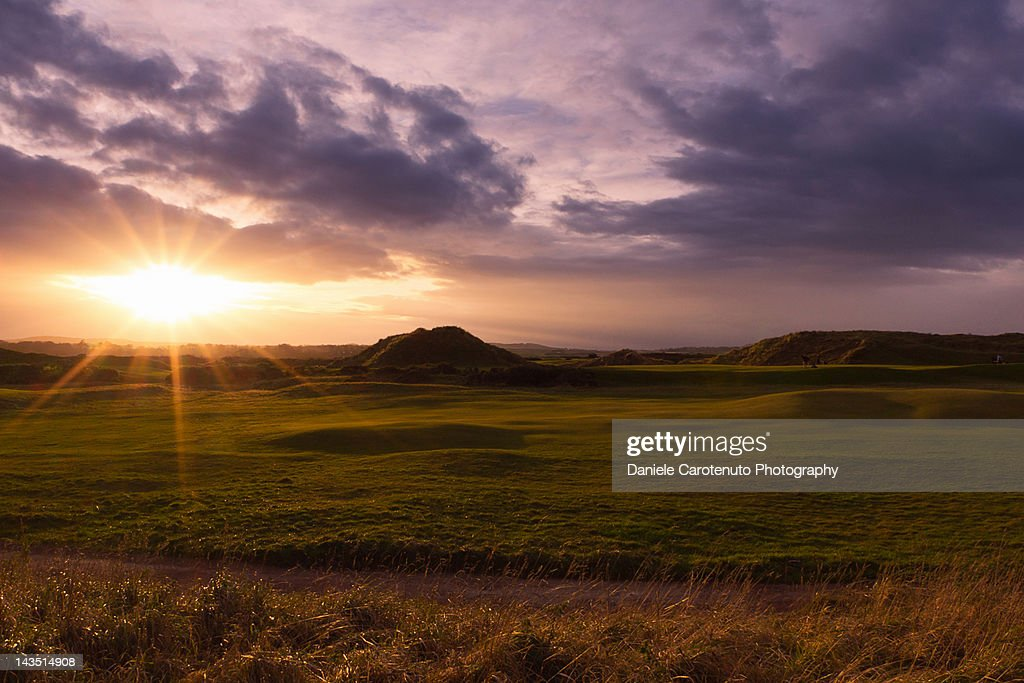 Golf at sunset : Stock Photo