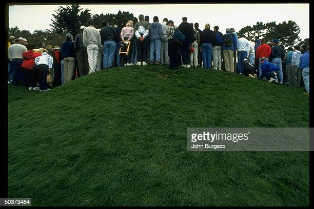 Pebble Beach Pro Am. Rear view of fans on hill.