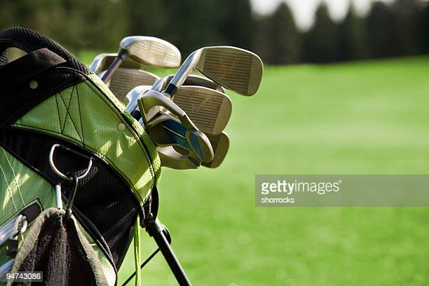 golf bag and clubs against grass - golf club stock pictures, royalty-free photos & images