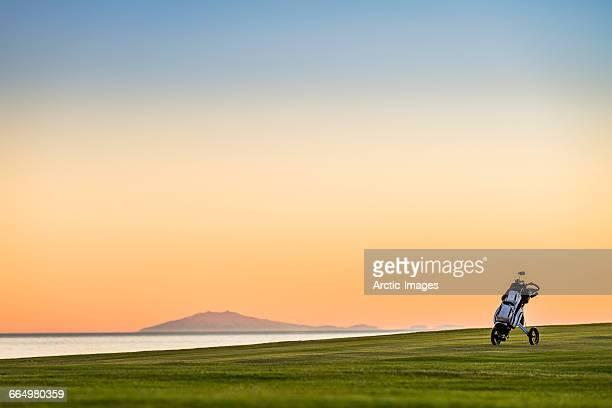 golf bag in a push cart, midnight sun, iceland - golfbana bildbanksfoton och bilder