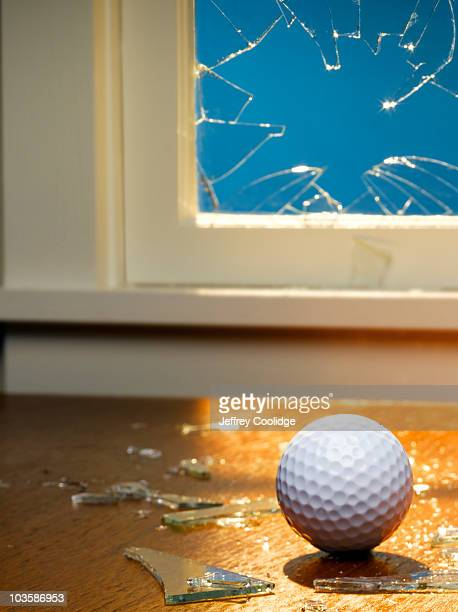 Golf Ball and Broken WIndow