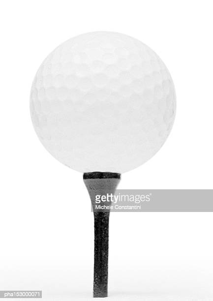 Golf ball and tee, b&w.