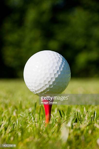 golf ball and tee, close up - tee sports equipment stock photos and pictures