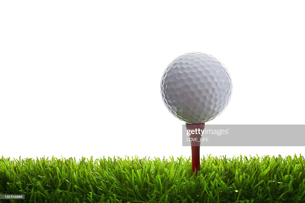 Golf Ball and Tee on grass : Stock Photo