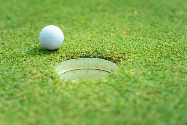 Golf ball close to hole