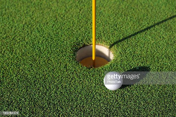 golf ball close to the hole - xlarge - putting green stock pictures, royalty-free photos & images