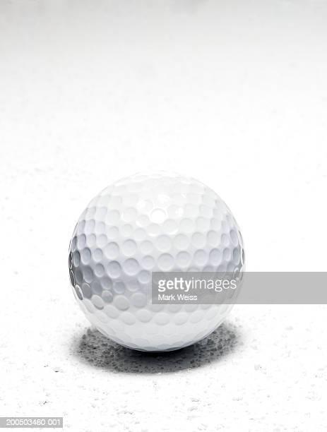 golf ball close-up, studio shot - ゴルフボール ストックフォトと画像