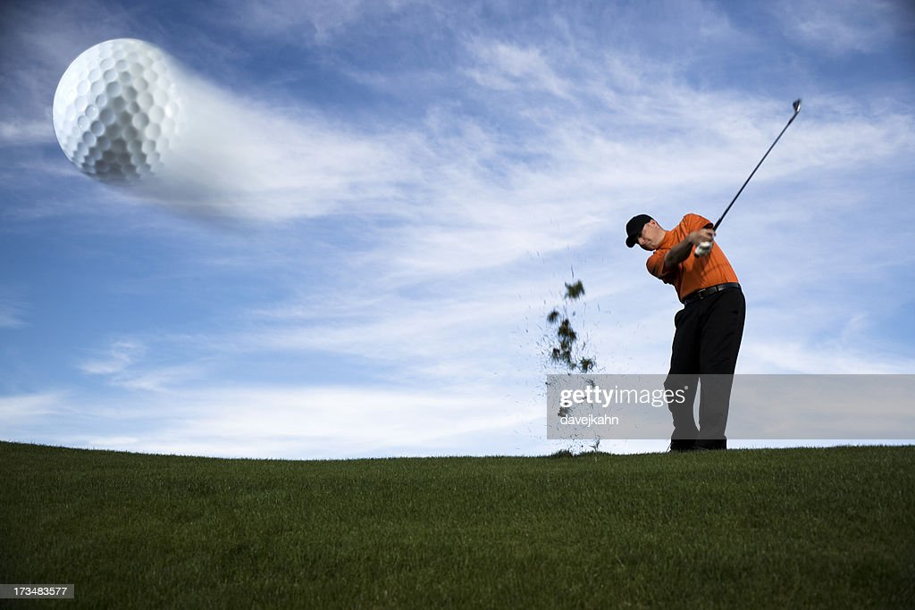 Golf Ball In Motion Stock Photo