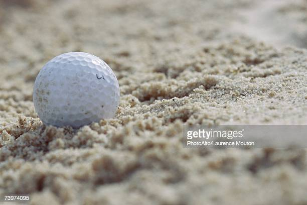 golf ball in sand, close-up - bunker stock pictures, royalty-free photos & images