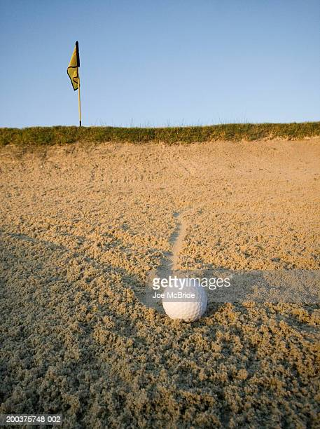 golf ball in sand trap at sunrise, ground view - bunker stock pictures, royalty-free photos & images