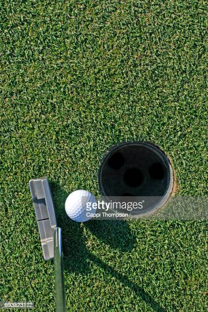 golf ball near hole - golf background stock photos and pictures
