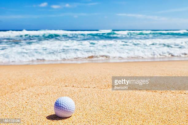 golf ball on beach - golf background stock photos and pictures