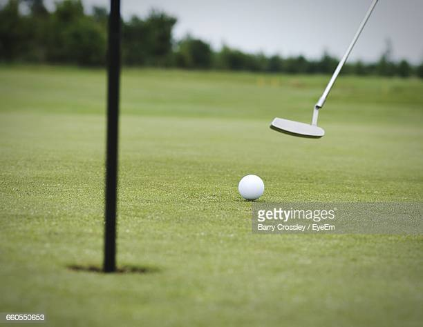 golf ball on field - putting stock pictures, royalty-free photos & images