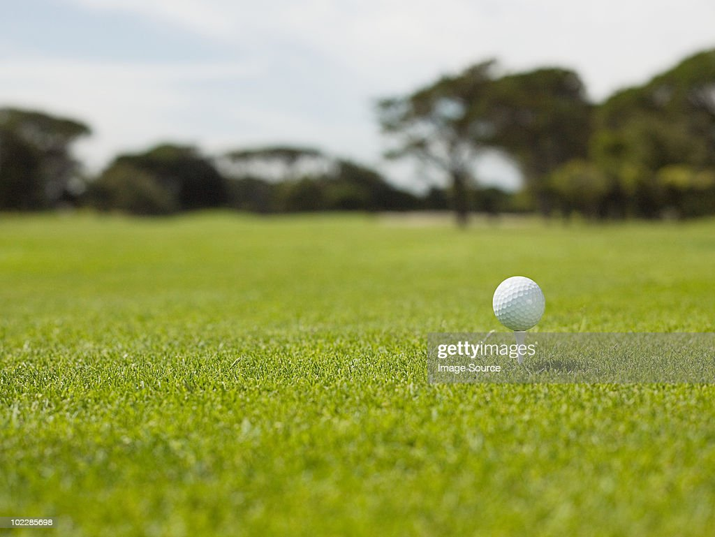 Golf ball on golf course, close up : Stock Photo