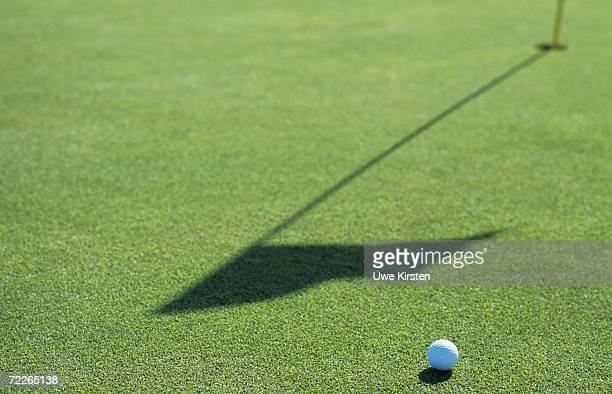 Golf ball on golf course, close-up