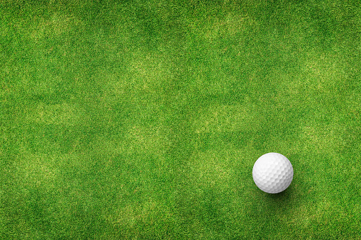 golf ball on grass top view 825397576