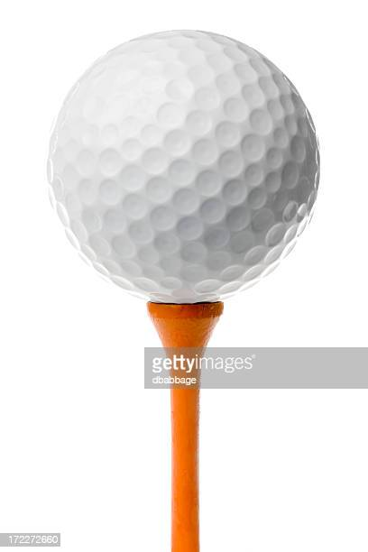 Golf ball on orange tee