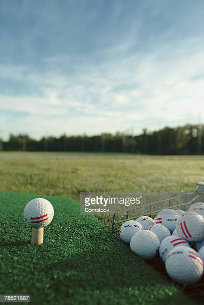 golf ball on tee - driving range stock photos and pictures