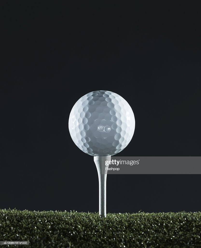 Golf ball on tee (surface level) : Stock Photo