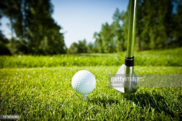 golf ball on tee, teeing off - teeing off stock pictures, royalty-free photos & images