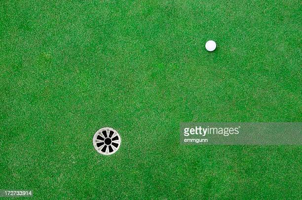 golf ball on the green - putting green stock pictures, royalty-free photos & images