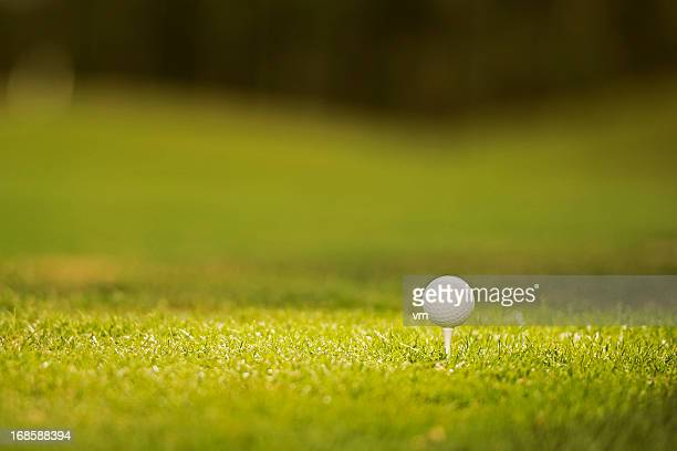 golf ball on the tee - teeing off stock pictures, royalty-free photos & images