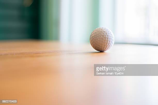Golf Ball On Wooden Table