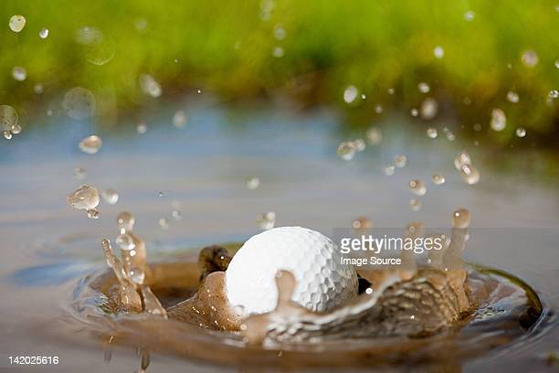 Golf ball splashing into water