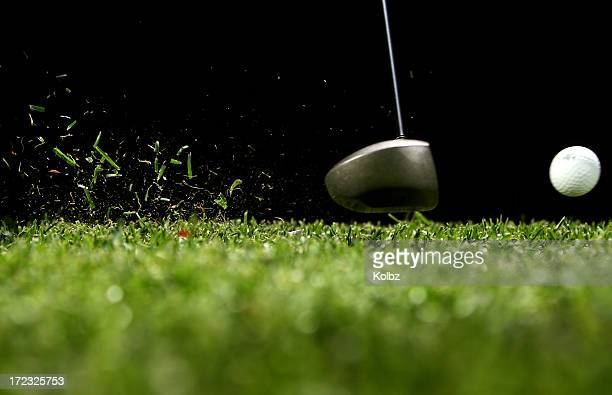golf ball struck by driver with black background - golf swing stock pictures, royalty-free photos & images