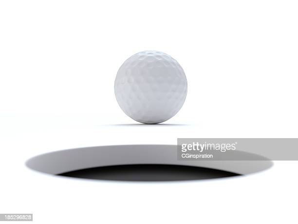 golf ball very close to the hole - hole stock pictures, royalty-free photos & images
