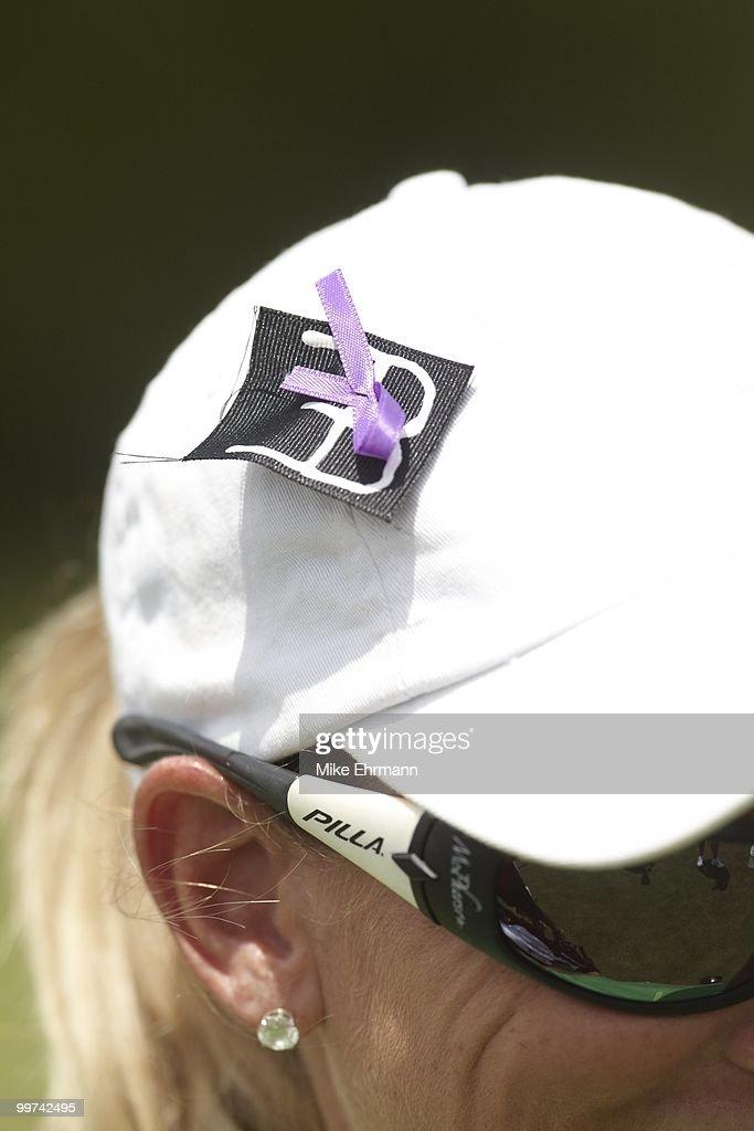 Closeup of ribbon on cap of Kristy McPherson in memorial of Erica Blasberg during Saturday play at Robert Trent Jones Golf Trail at Magnolia Grove. Mobile, AL 5/15/2010