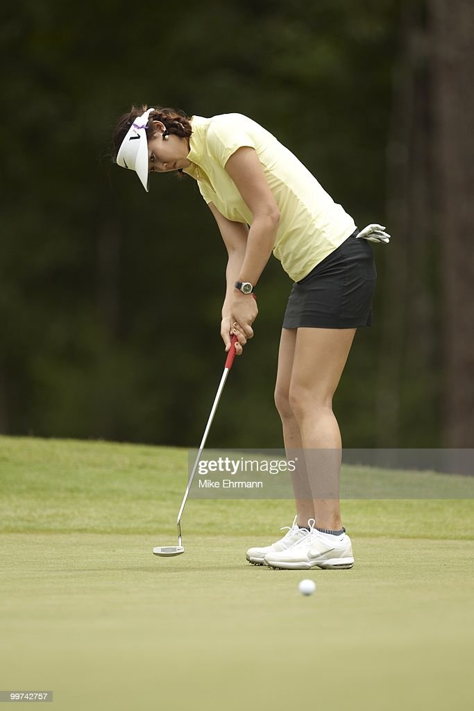 Michelle Wie in action, putt on No 3 green during Thursday play at Robert Trent Jones Golf Trail at Magnolia Grove. Mobile, AL 5/13/2010