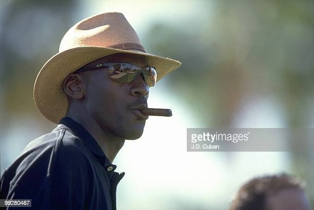 Bob Hope Classic Closeup of basketball player Michael Jordan smoking cigar during Thursday play in La Quinta Palm Springs CA 1/21/1999 CREDIT JD Cuban
