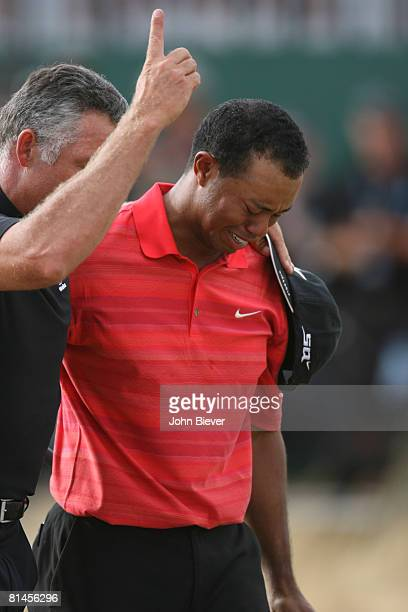 Golf: British Open, Closeup of Tiger Woods victorious, crying with caddie Steve Williams after winning on Sunday at Royal Liverpool GC, Hoylake,...