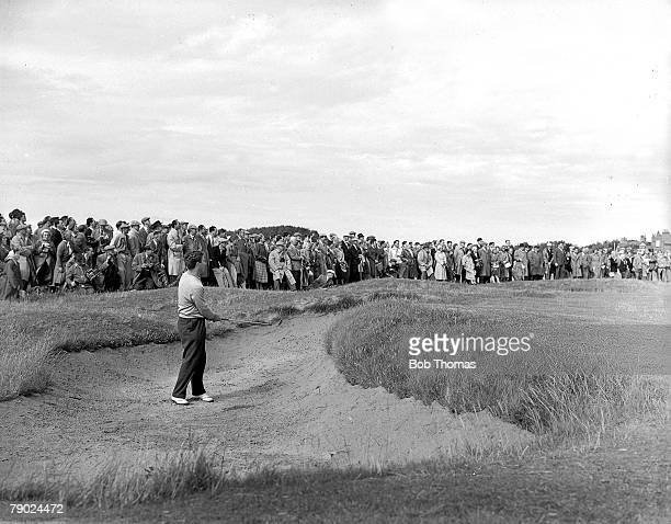 Golf British Open Golf Championships July 1956 Royal Liverpool Australias Peter Thomson is pictured after playing a bunker shot with the crowds...