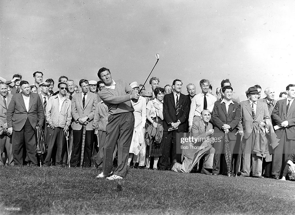Golf. British Open Golf Championships. July 1958. Royal Lytham St Annes, Lancashire. Australia+s Peter Thomson plays a pitch shot watched by spectators. Thomson won the Championship after a 32-hole play-off with Britain+s Dave Thomas by four shots. : News Photo
