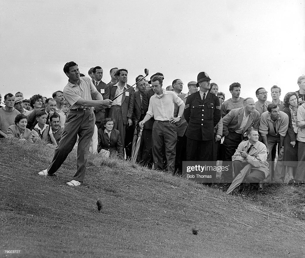 Golf. British Open Golf Championships. July 1958. Royal Lytham St Annes, Lancashire. Australia+s Peter Thomson plays a pitch shot from a slope on to the green watched by spectators. Thomson won the Championship after a 32-hole play-off with Britain+s Dave : News Photo