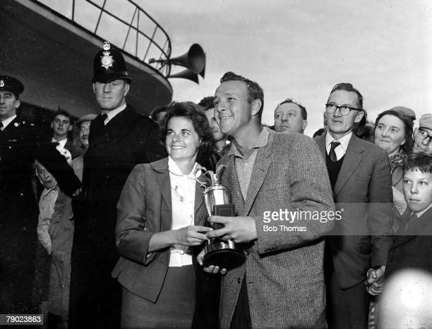 Golf British Open Golf Championships July 1961 Royal Birkdale Southport USAs legendary golfer Arnold Palmer is pictured with his wife Winnie holding...
