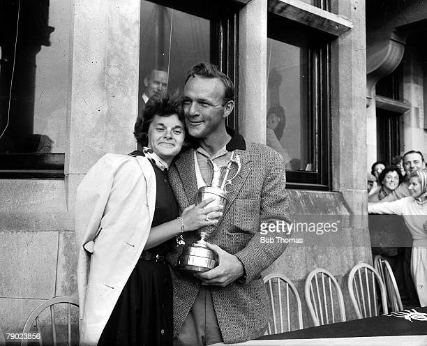 Golf British Open Golf Championships July 1962 Royal Troon Scotland USAs legendary golfer Arnold Palmer is pictured with his wife Winnie holding the...