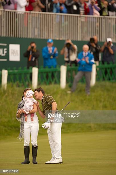 British Open Louis Oosthuizen victorious with wife NelMare and daughter Jana on No 18 green after winning tournament on Sunday at Old Course St...