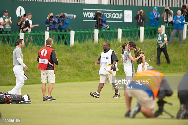 British Open Louis Oosthuizen victorious with wife NelMare on No 18 green after winning tournament on Sunday at Old Course View of caddie Zack Rasego...
