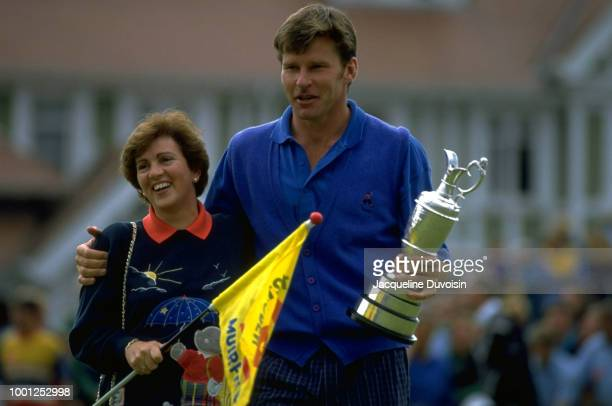 British Open Nick Faldo victorious with his wife Gill Bennett holding Claret Jug trophy after winning tournament on Sunday at Muirfield Golf Links...