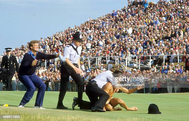 British Open Peter Jacobsen helping police subdue a streaker during Sunday play at Royal St George's GC Sandwich England 7/21/1985 CREDIT Jacqueline...