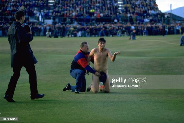Golf British Open Police office covering male streaker Mark Roberts after running on green during Sunday play St Andrews GBR 7/23/1995