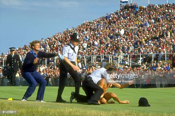 Golf British Open Police officers subduing streaker on No 18 green after Peter Jacobsen tackle during Sunday play at Royal St George's Sandwich...