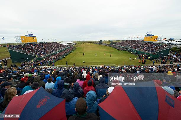 British Open Scenic view of Thomas Bjorn in action putt on No 18 green as Rickie Fowler watches during Sunday play at Royal St George's GC Sandwich...