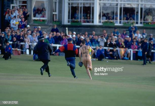 British Open View of male streaker being chased naked across course during tournament at Old Course St Andrews Scotland 7/20/1995 7/23/1995 CREDIT...