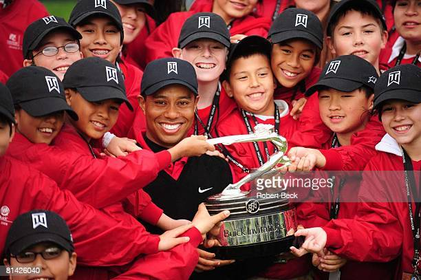 Golf Buick Invitational Tiger Woods victorious with trophy and children from Tiger Woods Foundation after winning tournament on Sunday at Torrey...